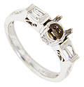 Baguette diamonds are set in the shoulders of this 14K white gold antique style mounting