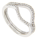 A single row of diamonds decorates the top half of each of these 14K white gold curved wedding bands