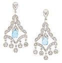A single, faceted blue topaz briolette dangles at the center of these 14K white gold antique style earrings