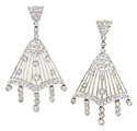 Diamonds dangle from fan shapes on these 14K white gold antique style earrings while additional diamonds are used as sparkling accents
