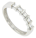 Five sparkling baguette diamonds are set across the top of this platinum antique style wedding band