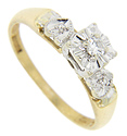 Heart shapes adorn the shoulders of this 14K bi-color gold antique engagement ring
