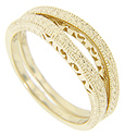 Intricate engraved patterns ornament these 14K yellow gold curved wedding bands