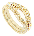 An undulating design flows across the top of these 14K yellow gold curved wedding bands
