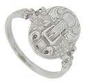 A floral and buckle pattern decorates the oval top of this 14K white gold antique style ring