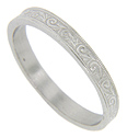 A curving floral design covers the surface of this 14K white gold antique style wedding band