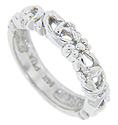 A flowing floral design decorates the top 2/3 of this 14K white gold antique style wedding band
