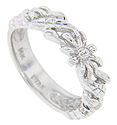 A leafy floral pattern ornaments the top 2/3 of this 14K white gold antique style wedding band