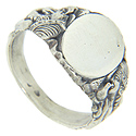 Figures in relief ornament the shoulders of this antique style sterling silver signet ring