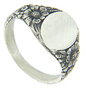 Repousse floral patterns cover the shoulders of this antique style sterling silver signet ring