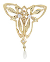 This 14K yellow gold Art Nouveau style brooch has 2 round pearls and a freshwater pearl at the bottom