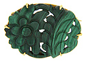 Malachite carved in a floral motif is held in a 14K yellow gold frame on this lovely art nouveau pin