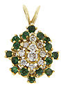 This 14K yellow gold estate pendant has brilliant emeralds surrounding a cluster of diamonds