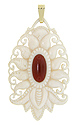 A central carnelian stone is the focus of this art deco ivory and carnelian pendant