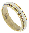 A band of white gold overlays a yellow gold base on this 14K gold vintage wedding band