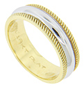 Diagonal striations decorate the 18K yellow gold edges of this antique style wedding band
