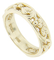 A vine and grape motif spans 3/4 of the circumference of this 14K yellow gold antique style wedding band