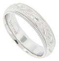 Engraved floral designs decorate the slightly rounded surface of this 14K white gold antique style men's wedding band