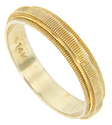 Horizontal engraved lines cover the surface of this 14K yellow gold vintage wedding band