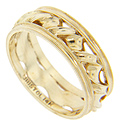 A spiraling design ornaments the center of this 14K yellow gold vintage band