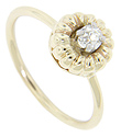 A .18 carat mine cut diamond is set at the center of a flower design on this 14K yellow gold vintage engagement ring
