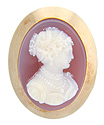 A simple, unadorned 14K yellow gold frame surrounds this antique stone cameo