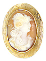 This intricately carved antique shell cameo depicts a woman in profile with long flowing hair
