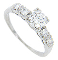 Pairs of round diamonds are set in the shoulders of this 14K white gold antique engagement ring