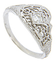 This 14K white gold antique style mounting features lovely filigree and engraving
