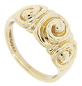 Swirling designs ornament the top of this 14K yellow gold estate wedding band
