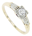 This 14K yellow gold antique engagement ring features a .20 carat H color Si1 clarity diamond set in the rings white gold top