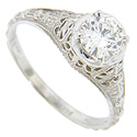 A brilliant .75 carat H color Si2 clarity round diamond is the focal point of this lovely 14K white gold antique style engagement ring