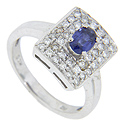 Two concentric rectangles of diamonds surround the .65 carat oval blue sapphire at the center of this antique style ring