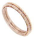 A pattern of triple gold beads alternates with smooth gold bars on these 14K red gold antique style stackable wedding bands