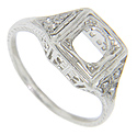 Trios of diamonds are set in the shoulders of this antique style platinum mounting