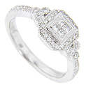 A quartet of square diamonds is set together at the center of this 14K white gold antique style engagement ring