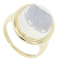 A large oval moonstone is set in this simply styled 14K yellow gold vintage ring
