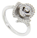 Diamonds are set on the curving edges of the petals on this blooming flower 14K white gold antique style engagement ring