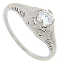 Subtle floral engraving decorates this 18K white gold antique style engagement ring