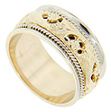 A yellow gold floral design is flanked white gold edges on this antique style 14K gold wedding band