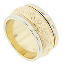 Flanked by white gold edges, the yellow gold center of this 14K gold antique style wedding band is engraved with a floral design