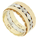 Diamonds and flower designs form a white gold strip at the center of this 14K gold antique style wedding band