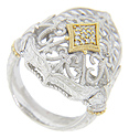This antique style ring is crafted of a combination of sterling silver and 18K yellow gold