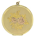 This exquisitely engraved gold-filled vintage locket displays two roses in red gold surrounded by leaves of yellow gold
