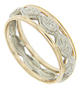 Ornamented marquis shapes in white gold form the center of this 14K gold bi-color vintage wedding band