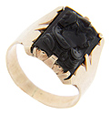 A rectangular piece of onyx is carved into a cameo on this 9K rose gold antique ring