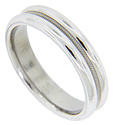 A simple recessed milgrain pattern runs down the center of this antique style men's wedding band