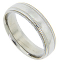 Four milgrain rings span the circumference of this 14K white gold antique style men's wedding band