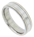 A raised center strip ornamented with milgrain patterning decorates this antique style mens wedding band