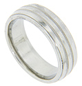 Milgrain patterns are separated by smoothly polished strips on this modern men's wedding band